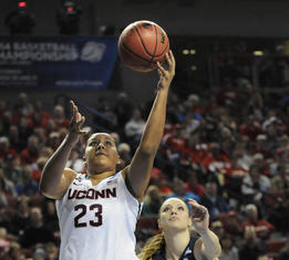 UConn forward Kaleena Mosqueda-Lewis goes for a layup ahead of Brigham Young guard Kim Beeston in the first half.