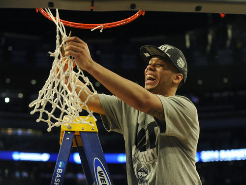 UConn's Shabazz Napier cuts down the net after defeating Michigan State in the NCAA East Regional final Sunday at Madison Square Garden.