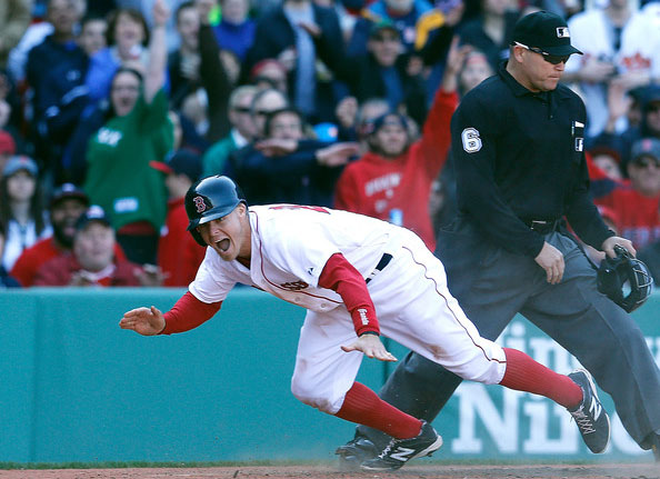 Brock Holt #26 of the Boston Red Sox reacts after he scored on a suicide squeeze against the Baltimore Orioles in the seventh inning at Fenway Park on April 19, 2014 in Boston, Massachusetts.