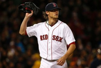 Boston Red Sox starting pitcher Clay Buchholz leaves the mound after giving up three runs to the Milwaukee Brewers during the third inning of a baseball game at Fenway Park in Boston, Saturday, April 5, 2014.