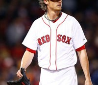 Clay Buchholz #11 of the Boston Red Sox walks off of the field after giving up three runs in the third inning against the Milwaukee Brewers in the first inning during the game at Fenway Park on April 5, 2014 in Boston, Massachusetts.