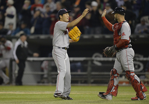 Relief pitcher Koji Uehara #19 (L) and catcher David Ross #3 of the Boston Red Sox celebrate their win over the Chicago White Sox at U.S. Cellular Field on April 17, 2014 in Chicago, Illinois.