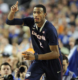 DeAndre Daniels signals after scoring a three-pointer in the second half as UConn pulled ahead.