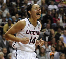 UConn guard Bria Hartley jumps for joy after making a shot and drawing a foul in the second half against Stanford.