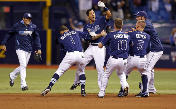 Cole Figueroa #35 of the Tampa Bay Rays (C) is congratulated by teammates after hitting a walk-off RBI double in the ninth inning of a baseball game against the Boston Red Sox at Tropicana Field on May 23, 2014 in St. Petersburg, Florida.