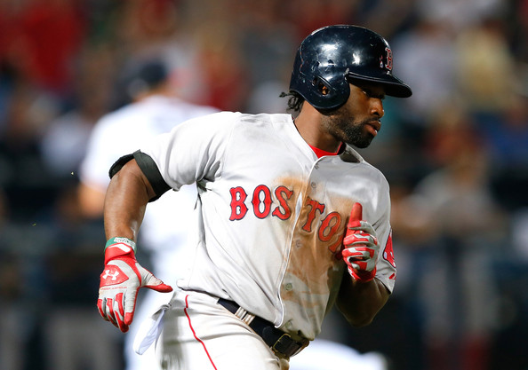 Jackie Bradley Jr. #25 of the Boston Red Sox hits a two-run single in the seventh inning against the Atlanta Braves at Turner Field on May 27, 2014 in Atlanta, Georgia.