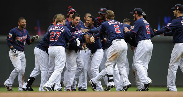 The Minnesota Twins celebrate a walk-off single against the Boston Red Sox by Aaron Hicks #32 during the tenth inning of the game on May 15, 2014 at Target Field in Minneapolis, Minnesota.