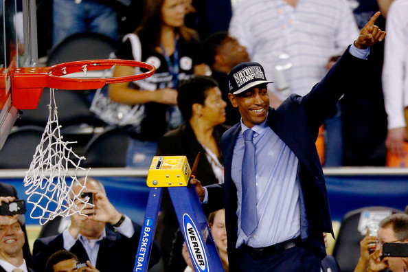 Head coach Kevin Ollie of the Connecticut Huskies acknowledges the crowd after defeating the Kentucky Wildcats 60-54 in the NCAA Men's Final Four Championship at AT&T Stadium on April 7, 2014 in Arlington, Texas.