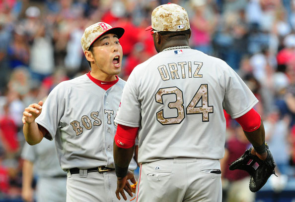Koji Uehara #19 of the Boston Red Sox celebrates with David Ortiz #34 after the game against the Atlanta Braves at Turner Field on May 26, 2014 in Atlanta, Georgia.
