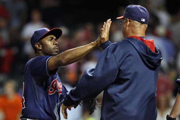 Michael Bourn #24 of the Cleveland Indians is congratulated by Manager Terry Francona #17 after the Indians defeated the Boston Red Sox on June 3, 2014 at Progressive Field in Cleveland, Ohio.