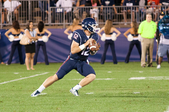 UConn QB Casey Cochran (12) drops back to pass in the second quarter on August 29, 2014 at Rentschler Field in East Hartford, CT