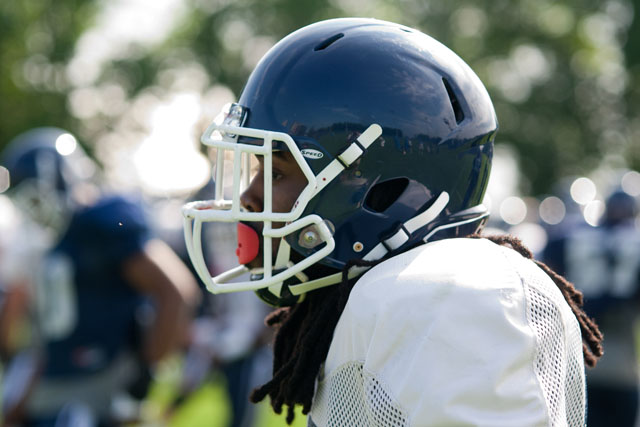 UConn WR Geremy Davis looks on during the stretching drills at practice on Wednesday, August 6, 2014.