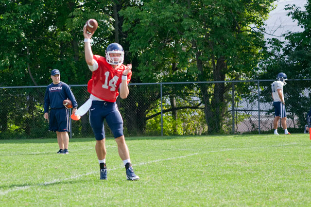 UConn QB Tim Boyle (14) throws a pass during practice.