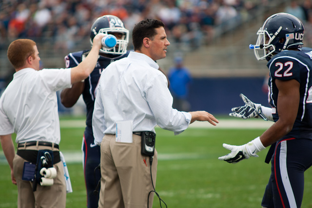 UConn head coach Bob Diaco talks with #22 Andrew Adams during at timeout against Boise State at Rentschler Field on September 13, 2014.