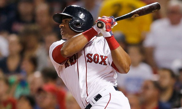 Yoenis Cespedes #52 of the Boston Red Sox doubles in a run in the third inning against the Toronto Blue Jays at Fenway Park on September 6, 2014 in Boston, Massachusetts.