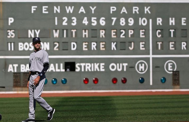 New York Yankees' Derek Jeter walks on the field in front of a message to him on the Green Monster scoreboard at Fenway Park, prior to the Yankees' baseball game against the Boston Red Sox, Sunday, Sept. 28, 2014, in Boston. It is the last baseball game of Jeter's career.