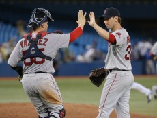 Craig Breslow #32 of the Boston Red Sox celebrates their victory with Christian Vazquez #55 during MLB game action against the Toronto Blue Jays on August 25, 2014 at Rogers Centre in Toronto, Ontario, Canada.