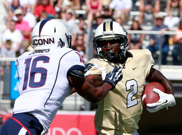 ORLANDO, FL - OCTOBER 26:  Jeff Godfrey #2 of the UCF Knights attempts to run past Byron Jones #16 of the Connecticut Huskies during the game at Bright House Networks Stadium on October 26, 2013 in Orlando, Florida.  (Photo by Sam Greenwood/Getty Images)