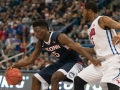 UConn's Daniel Hamilton (5) makes a move to the basket during the 2015 American Athletic Conference men's championship finals between the SMU Mustangs and the UConn Huskies at the XL Center in Hartford, CT.
