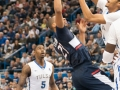 UConn's Omar Calhoun (21) puts up a floater in the lane during the American Athletic Conference men's championship semifinals between the Tulsa Golden Hurricane and the UConn Huskies at the XL Center in Hartford, CT.