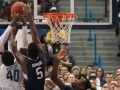 UConn's Daniel Hamilton (5) blocks a shot during the American Athletic Conference men's championship semifinals between the Tulsa Golden Hurricane and the UConn Huskies at the XL Center in Hartford, CT.