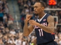 UConn's Ryan Boatright (11) celebrates after a three-pointer during the American Athletic Conference men's championship semifinals between the Tulsa Golden Hurricane and the UConn Huskies at the XL Center in Hartford, CT.