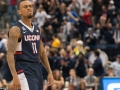 UConn's Ryan Boatright (11) celebrates at a timeout during the American Athletic Conference men's championship semifinals between the Tulsa Golden Hurricane and the UConn Huskies at the XL Center in Hartford, CT.