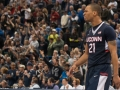 UConn's Omar Calhoun (21) celebrates his teams win during the American Athletic Conference men's championship semifinals between the Tulsa Golden Hurricane and the UConn Huskies at the XL Center in Hartford, CT.