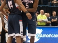UConn's Rodney Purvis (44) and Daniel Hamilton (5) celebrate during the American Athletic Conference men's championship semifinals between the Tulsa Golden Hurricane and the UConn Huskies at the XL Center in Hartford, CT.