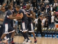 UConn celebrates their 47-42 win at the American Athletic Conference men's championship semifinals between the Tulsa Golden Hurricane and the UConn Huskies at the XL Center in Hartford, CT.