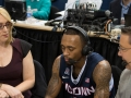 UConn's Ryan Boatright (11) talks with ESPN's Doris Burke and Dave O'Brien after the win over Tulsa at the American Athletic Conference men's championship semifinals between the Tulsa Golden Hurricane and the UConn Huskies at the XL Center in Hartford, CT.