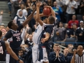UConn's Omar Calhoun (21) blocks a shot during the American Athletic Conference men's championship semifinals between the Tulsa Golden Hurricane and the UConn Huskies at the XL Center in Hartford, CT.