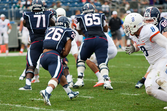 UConn RB #26 Joshua Marriner looks for a gap created by the offensive line in the fourth quarter against Boise State.