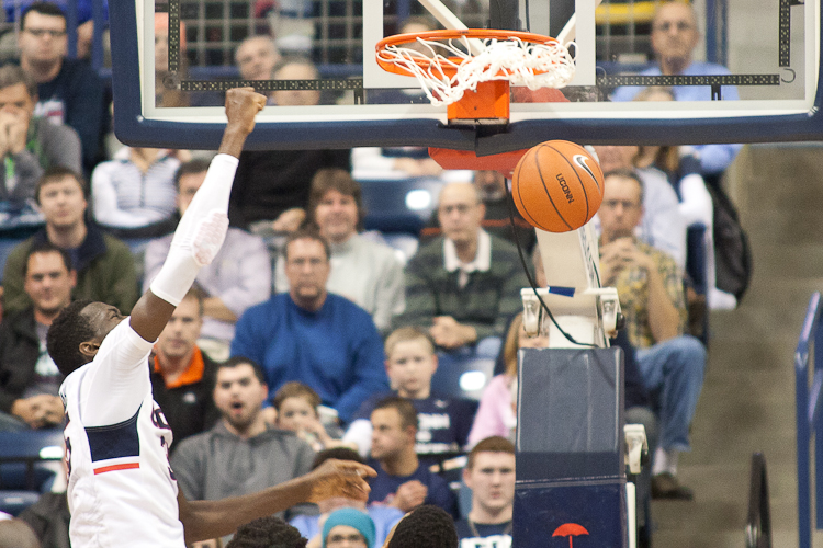 UConn C #35 Amida Brimah puts home a slam dunk in the second half against Bryant at Gampel Pavilion on November 14, 2014.