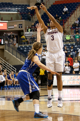 UConn F Morgan Tuck (3) attempts a three-pointer against Creighton at Gampel Pavilion on November 23, 2014.