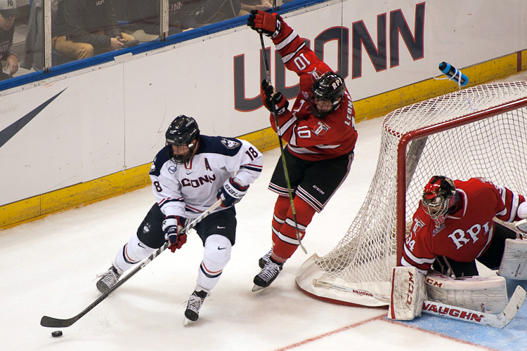 UConn F #18 Trevor Gerling tries to bring the puck around to the front of the goal against RPI in the third period at the XL Center on November 18, 2014.