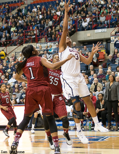 UConn F Morgan Tuck (3) makes a layup against Temple in the first half at Gampel Pavilion.