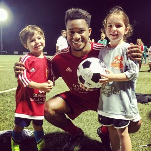 Karl Chester poses with young Hammers fans. Chester scored the Hammers first goal in franchise history.