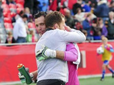 Fury head coach Marc Dos Santos and Fury keeper Romuald Peiser embrace following playoff-clinching win.