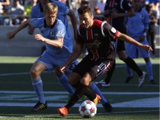 Minnesota United FC Greg Jordan, left, and the Ottawa Fury FC Sinisa Ubiparipovic chase the ball during the first half of their soccer match at TD Place in Ottawa on Sunday, September 28, 2014.   (Patrick Doyle / Ottawa Citizen)  ORG XMIT: 0928 fury06