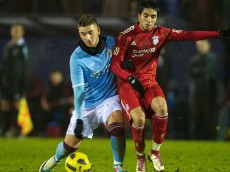 MANCHESTER, ENGLAND - Wednesday, January 19, 2011: Liverpool's Gerardo Bruna in action against Manchester City's Andrea Mancini, son of Manchester City's manager Roberto Mancini, during the Lancashire Senior Cup Quarter-Final match at Ewen Fields. (Photo by David Rawcliffe/Propaganda)