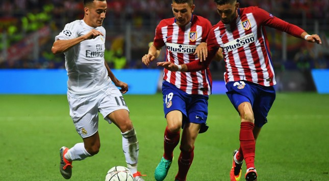 MILAN, ITALY - MAY 28:  Lucas Vazquez of Real Madrid takes on Lucas Hernandez (C) and Yannick Carrasco of Atletico Madrid (R) during the UEFA Champions League Final match between Real Madrid and Club Atletico de Madrid at Stadio Giuseppe Meazza on May 28, 2016 in Milan, Italy.  (Photo by Matthias Hangst/Getty Images)