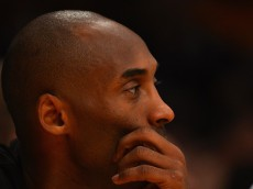 LOS ANGELES, CA - DECEMBER 09:  Kobe Bryant #24 of the Los Angeles Lakers watches from the bench during a game against the Sacramento Kings at Staples Center on December 9, 2014 in Los Angeles, California.   NOTE TO USER: User expressly acknowledges and agrees that, by downloading and or using this photograph, User is consenting to the terms and conditions of the Getty Images License Agreement.  (Photo by Jonathan Moore/Getty Images)