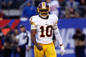 EAST RUTHERFORD, NJ - DECEMBER 14:  Robert Griffin III #10 of the Washington Redskins runs off the field after a play against the New York Giants during their game at MetLife Stadium on December 14, 2014 in East Rutherford, New Jersey.  (Photo by Jeff Zelevansky/Getty Images)