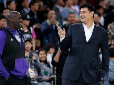 BEIJING, CHINA - OCTOBER 15:  Yao Ming (R) former NBA basketball star talk with Shaquille O'Neal during the 2014 NBA Global Games match between the Brooklyn Nets and Sacramento Kings at MasterCard Center on October 15, 2014 in Beijing, China.  NOTE TO USER: User expressly acknowledges and agrees that, by downloading and/or using this photograph, user is consenting to the terms and conditions of the Getty Images License Agreement.  (Photo by Lintao Zhang/Getty Images)