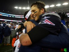 FOXBORO, MA - JANUARY 18:  Tom Brady #12 of the New England Patriots celebrates after defeating the Indianapolis Colts in the 2015 AFC Championship Game at Gillette Stadium on January 18, 2015 in Foxboro, Massachusetts. The Patriots defeated the Colts 45-7. (Photo by Elsa/Getty Images)