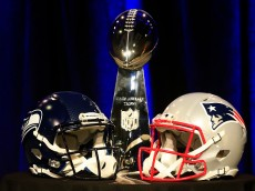 PHOENIX, AZ - JANUARY 30:  The Vince Lombardi Trophy is displayed between the helmets of the Seattle Seahawks (L) and New England Patriots prior to a joint press conference with Head Coach Bill Belichick of the New England Patriots and Head Coach Pete Carroll of the Seattle Seahawks prior to the upcoming Super Bowl XLIX on January 30, 2015 in Phoenix, Arizona.  (Photo by Rob Carr/Getty Images)