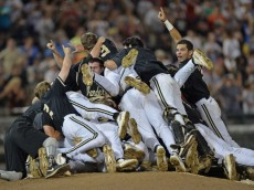 Omaha, NE - JUNE 25:  Vanderbilt Commodores players celebrated after beating the Virginia Cavaliers 3-2 to win the College World Series Championship Series on June 25, 2014 at TD Ameritrade Park in Omaha, Nebraska.  (Photo by Peter Aiken/Getty Images)