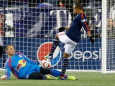 FOXBORO, MA - NOVEMBER 29: Teal Bunbury #10 of New England Revolution shoots on net as Luis Robles #31 of New York Red Bulls defends during the second half of Leg 2 of the MLS Eastern Conference game at Gillette Stadium on November 29, 2014 in Foxboro, Massachusetts.  (Photo by Jim Rogash/Getty Images)