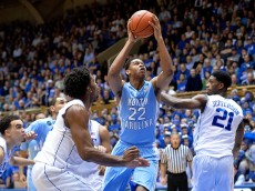 DURHAM, NC - FEBRUARY 18:  Isaiah Hicks #22 of the North Carolina Tar Heels drives between Justise Winslow #12 and Amile Jefferson #21 of the Duke Blue Devils during their game at Cameron Indoor Stadium on February 18, 2015 in Durham, North Carolina. Duke won 92-90 in overtime.  (Photo by Grant Halverson/Getty Images)
